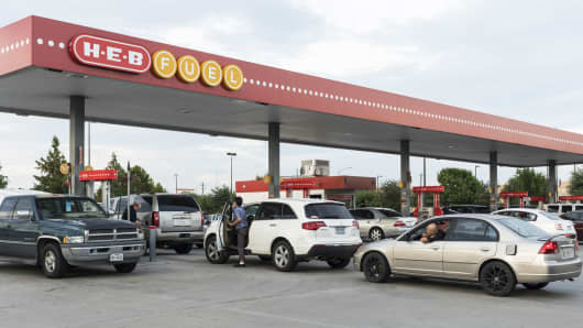 Customers wait in line to refuel at an HEB Fuel gas station in Houston, Texas, on Thursday, Aug. 24, 2017.