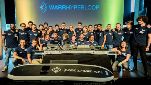 The WARR Hyperloop team from the Technical University of Munich pose with their pod in July