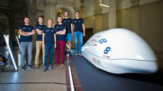 The Swissloop team posing with their hyperloop pod design