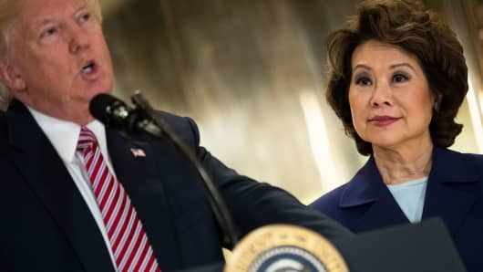Transportation Secretary Elaine Chao (R) looks on as President Donald Trump speaks following a meeting on infrastructure at Trump Tower, August 15, 2017 in New York City.