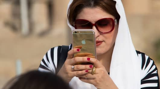 An Iranian woman taking pictures with an Apple iPhone in Tehran.