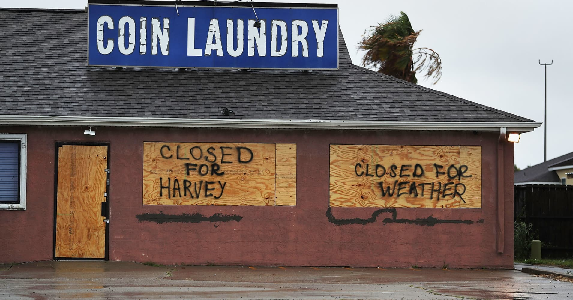 A sign on a business reads, 'Closed for Harvey', as people prepare for approaching Hurricane Harvey on August 25, 2017 in Corpus Christi, Texas.