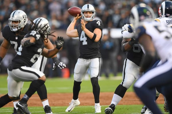 Derek Carr of the Oakland Raiders looks to throw a pass against the Los Angeles Rams during the first quarter of their preseason NFL football game at Oakland-Alameda County Coliseum on August 19, 2017 in Oakland, California.