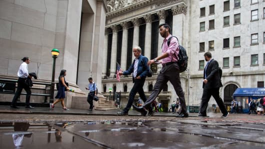 Dow edges to record but tech selloff hits Nasdaq