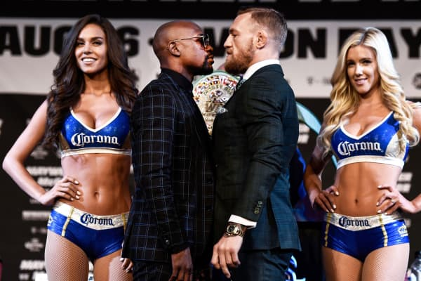 Boxer Floyd Mayweather Jr. and UFC lightweight champion Conor McGregor face off during a news conference at the KA Theatre at MGM Grand Hotel & Casino on August 23, 2017 in Las Vegas, Nevada.