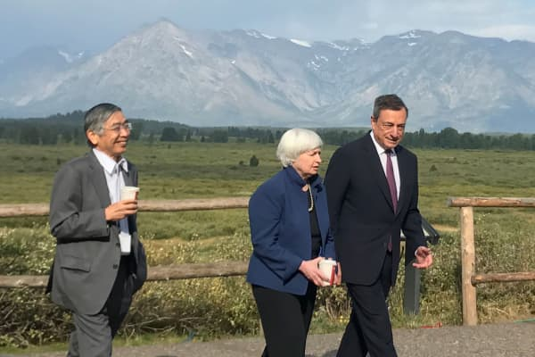 Governor of the Bank of Japan Haruhiko Kuroda (L to R), United States Federal Reserve Chair Janet Yellen and President of the European Central Bank Mario Draghi walk after posing for a photo opportunity during the annual central bank research conference in Jackson Hole, Wyoming, August 25, 2017.