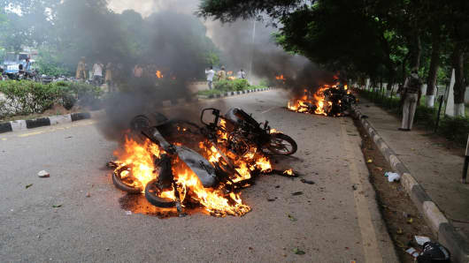 Burning vehicles are seen after Dera followers fire up the vehicles in Panchkula sector 4 after the Dera chief verdict at CBI court on August 25, 2017 in Panchkula, India.