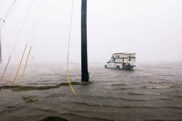 "Craig ""Cajun"" Uggen, 57, nearly floods his truck as Hurricane Harvey comes ashore in Corpus Christi, Texas. Minutes later, high winds blew off the camper carrying all of his belongings"