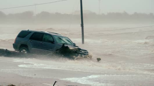A car surrounded by floodwaters in Point Comfort, Texas.