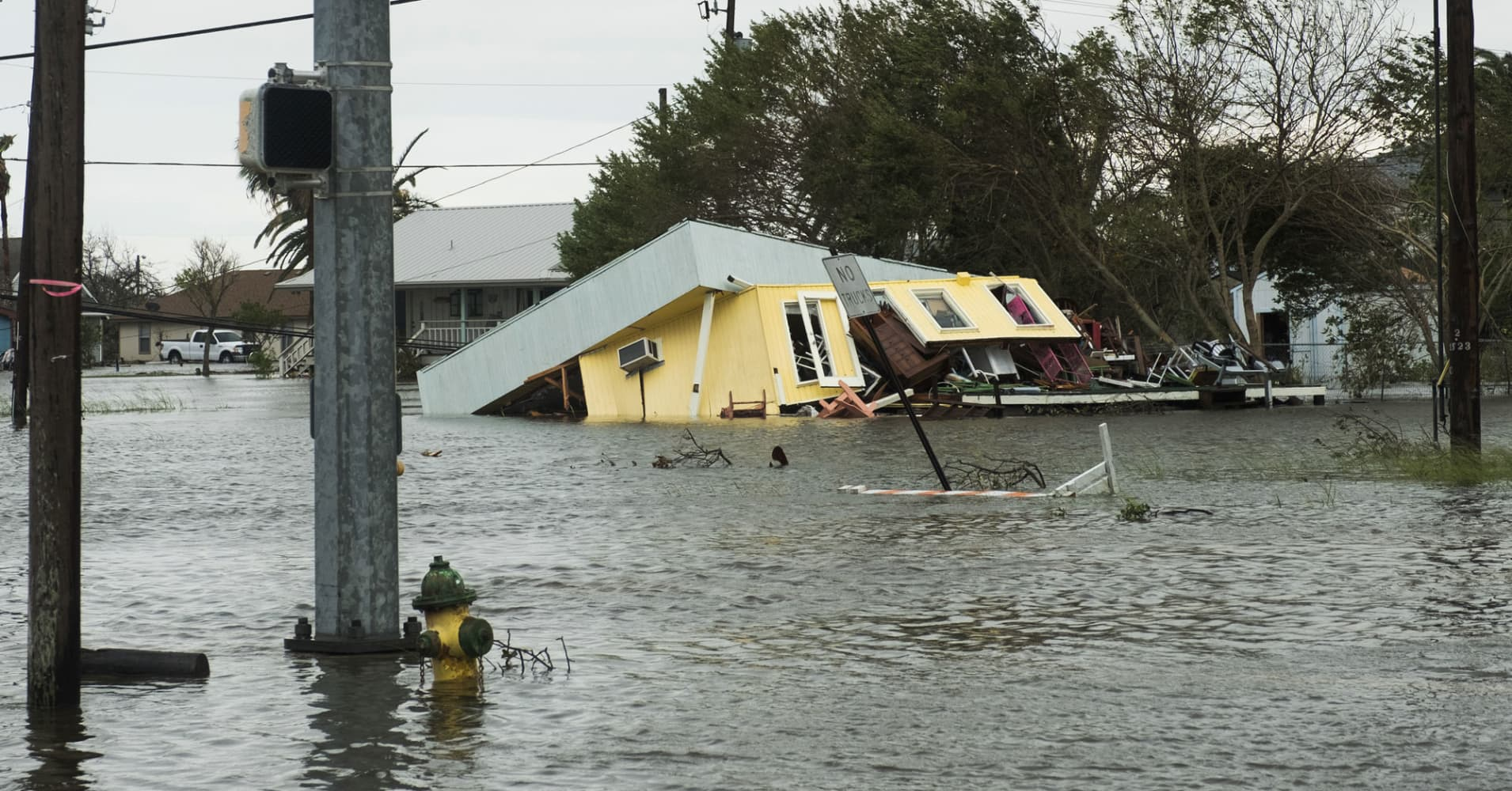 Crews rescue hundreds from homes and cars as Harvey floods ...