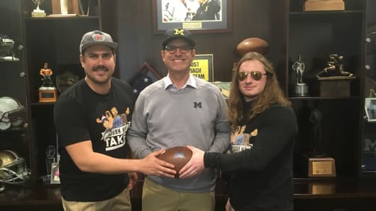 "The hosts of ""Pardon My Take"" with Michigan football coach Jim Harbaugh."