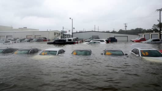 Vehicles are submerged at an auto dealership off Interstate 45 in Dickinson, Texas, Sunday, Aug. 27, 2017.