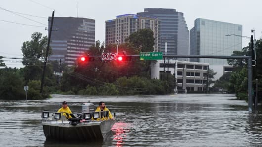 Rescue crews search for people in distress after Hurricane Harvey caused heavy flooding in Houston, Texas on August 27, 2017.
