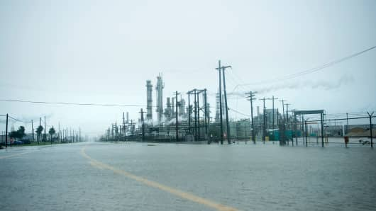 A view of the Marathon Texas City Refinery as rain from Hurricane Harvey floods a road on August 26, 2017 in Texas City, Texas.