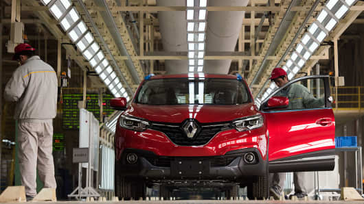 Employees working on a car assembly line of France's Renault and China's Dongfeng factory in Wuhan, Hubei province, China on on February 1, 2016.