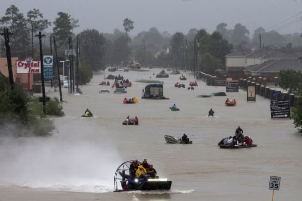 Residents use boats to evacuate flood waters from Tropical Storm Harvey along Tidwell Road east Houston, Texas, August 28, 2017.