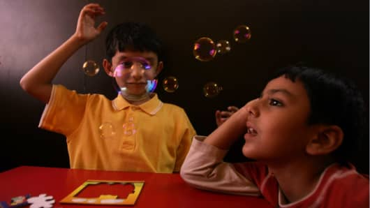 Autistic children play with bubbles in Mumbai,  India on April 1st, 2008
