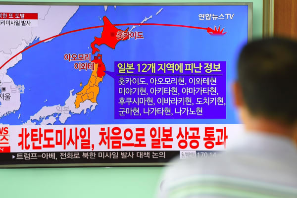 A man looks at a television news screen showing a graphic of a North Korean missile launch, at a railway station in Seoul on Aug. 29, 2017.