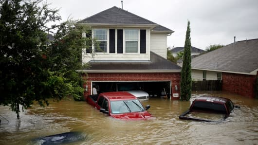 Houses and vehicles at the Highland Glen subdivision stand in floodwaters due to Hurricane Harvey in Spring, Texas, U.S., on Monday, Aug. 28, 2017.