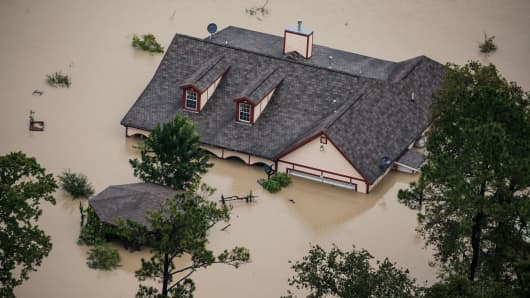 A house sits completely submerged in flood water in the wake of Hurricane Harvey in Houston, Texas, on Aug. 29, 2017.