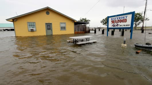 The Bayfront Seafood restaurant is surrounded by floodwaters in the aftermath of Hurricane Harvey Saturday, Aug. 26, 2017, in Palacios, Texas.