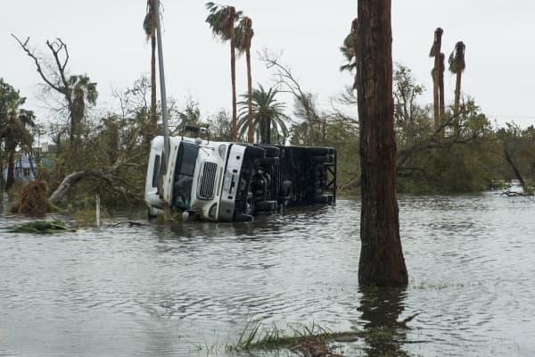A flipped over truck and flooding are seen after Hurricane Harvey hit Rockport, Texas, on Saturday, Aug. 26, 2017.
