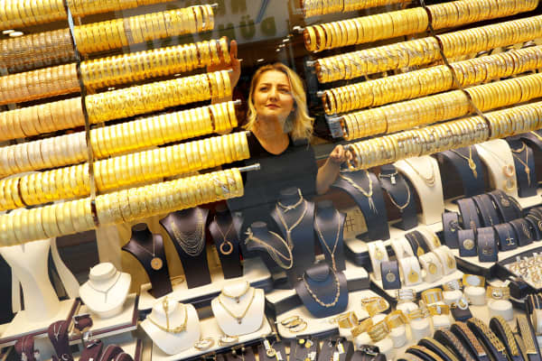 A woman checks products in a gold and jewelery store in Corum, Turkey.