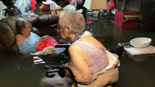 Residents of La Vita Bella assisted living facility are seen in waste-deep flooding due to Tropical Storm Harvey in Dickinson, Texas, U.S. August 27, 2017. Photo taken August 27, 2017.