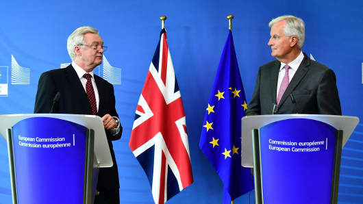 British Secretary of State for Exiting the EU David Davis (L) and EU Chief Negotiator in charge of Brexit negotiations Michel Barnier (R) address media representatives at the EU Commission Headquarters in Brussels on August 28, 2017.