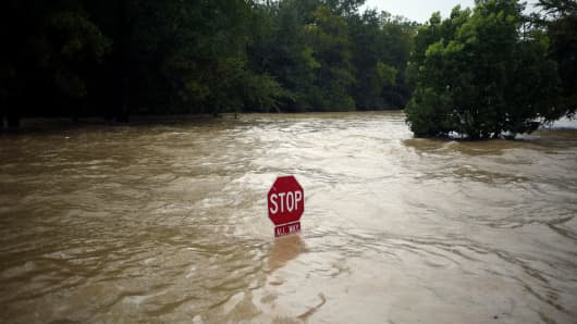 A 'Stop' sign stands in floodwaters due to Hurricane Harvey in Spring, Texas, Aug. 28, 2017.