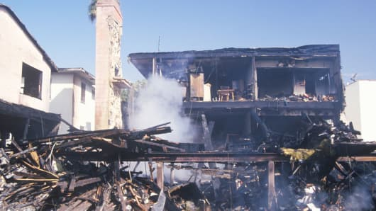 An apartment building on fire as a result of the Northridge earthquake in 1994.