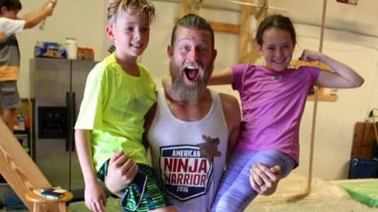 "American Ninja Warrior contestant Morgan ""Moose"" Wright, with his children Jaxon (left) and Josalyn (right)."
