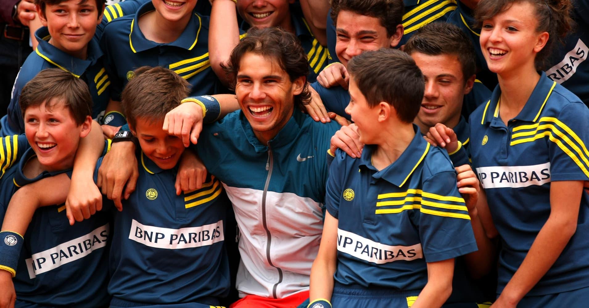 Tennis legend Rafael Nadal with the ballkids at Roland Garros in 2013