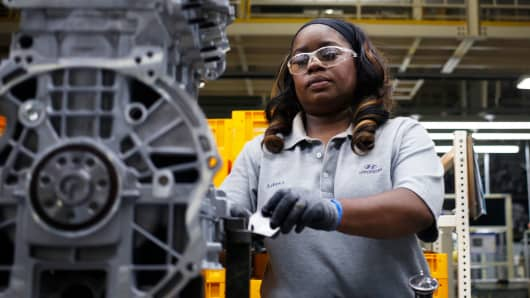 An employee assembles an engine on the production line at the Hyundai Motor Manufacturing Alabama facility in Montgomery, Alabama.