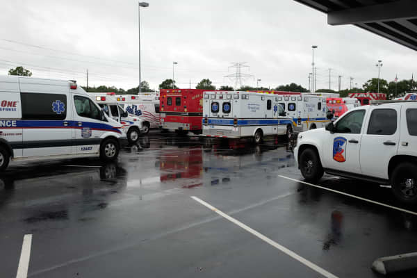 Emergency response vehicles in the Academy Sports + Outdoors parking lot.