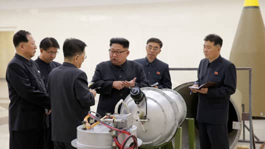 In an undated image distributed on Sept. 3, 2017, North Korean leader Kim Jong Un was inspecting the loading of a hydrogen bomb into a new ICBM, according to the North's state media.
