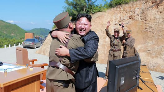 North Korean leader Kim Jong-Un celebrating the successful test-fire of the intercontinental ballistic missile Hwasong-14 at an undisclosed location.