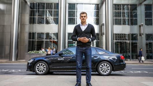 Taxify founder and chief executive Markus Villig stands in front of Taxify branded car