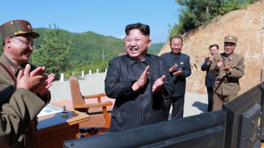 North Korean leader Kim Jong Un at the test-fire of the intercontinental ballistic missile Hwasong-14 at an undisclosed location