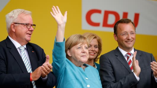 Michael Fuchs, German Chancellor and head of the German Christian Democrats (CDU) Angela Merkel, Chairman of CDU Rheinland-Pfalz Julia Kloeckner and Josef Oster, candidate for the German parliament, greet supporters after an election rally at the headland known as the 'Deutsches Eck' ('German Corner'), where the Mosel and Rhine rivers meet, on August 16, 2017 in Koblenz, Germany.