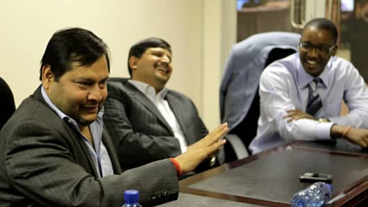 Businessmen Ajay and Atul Gupta with Duduzane Zuma, son of South Africa's president Jacob Zuma in Johannesburg in 2011