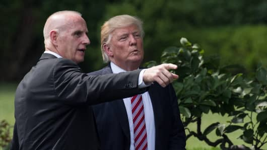 President Donald Trump listens to Director of Oval Office Operations Keith Schiller as he prepares to leave after welcoming the Clemson Tigers, the 2016 NCAA Football National Champions, at the White House in Washington, DC, on June 12, 2017.