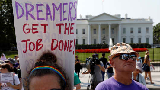 Demonstrators hold signs during a protest in front of the White House after the Trump administration today scrapped the Deferred Action for Childhood Arrivals (DACA), a program that protects from deportation almost 800,000 young men and women who were brought into the U.S. illegally as children, in Washington, U.S., September 5, 2017.