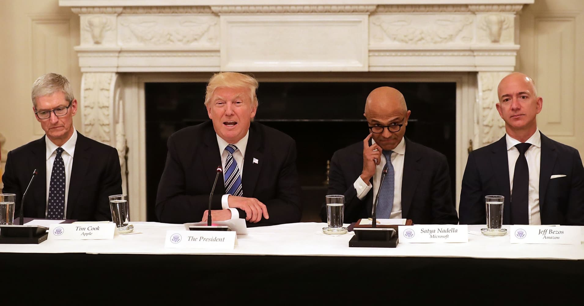 Apple CEO Tim Cook, Microsoft CEO Satya Nadella and Amazon CEO Jeff Bezos in the State Dining Room with President Trump.