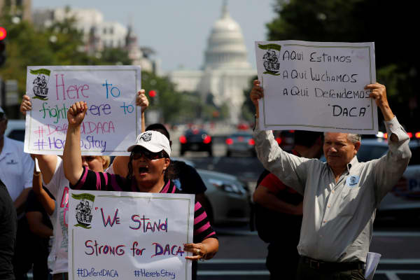 Protestors gather outside the Trump International Hotel to protest President Donald Trump's plan to repeal DACA in Washington, U.S., September 5, 2017.