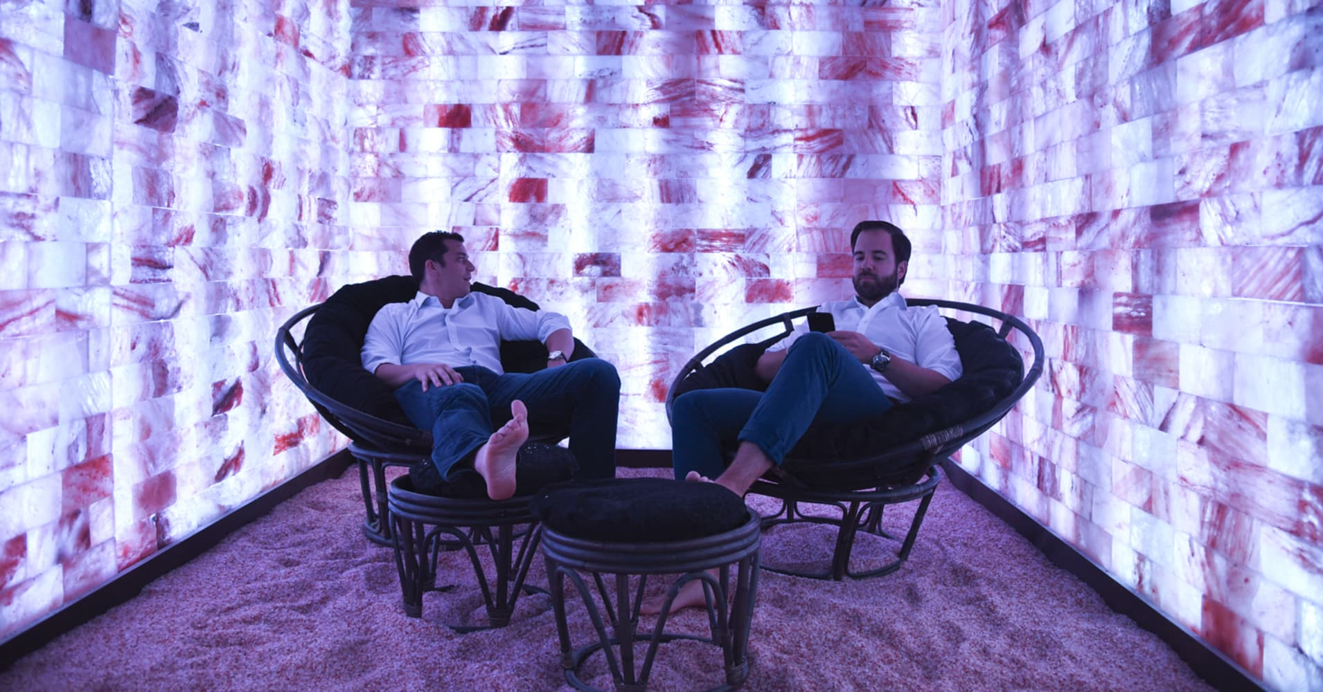 Erik Hess, left, and Marco Schnabl, both of automotiveMastermind, hold a meeting in a Himalayan salt room at Modrn Sanctuary in New York, Aug. 30, 2017.