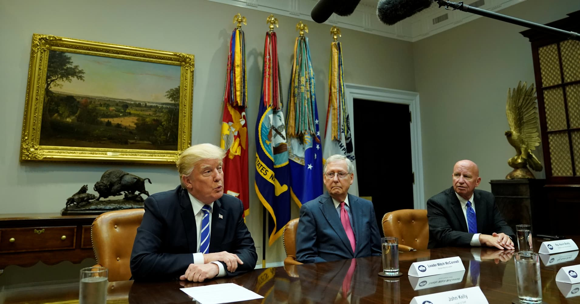 President Donald Trump speaks as Senate Majority Leader Mitch McConnell (R-KY) and Chairman of the House Ways and Means Committee Kevin Brady (R-TX) listen during a meeting of Republican congressional leaders about tax reform at the White House in Washington,DC, on September 5, 2017.