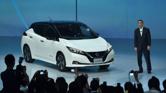 Nissan CEO Hiroto Saikawa unveils the company' new LEAF electric car at the world premiere in Makuhari, Chiba prefecture on September 6, 2017.
