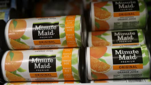 Minute Maid frozen orange juice is displayed in a freezer at a grocery store in San Rafael, California.