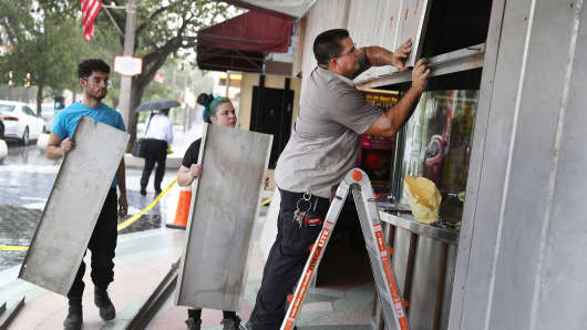 People put up shutters as they prepare the Actors' Playhouse at the Miracle Theatre for Hurricane Irma on September 6, 2017 in Miami, Florida.
